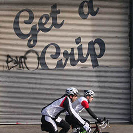 Cyclists and get a grip sign