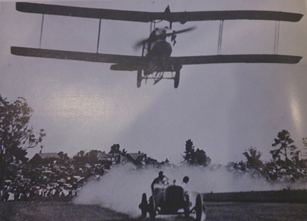 Itala racing an aeroplane at Aspendale race track