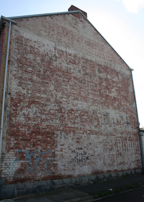 Grocer with faded ghostsigns